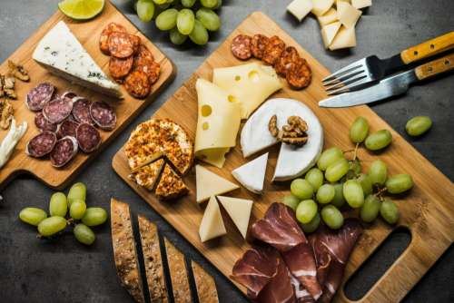 Cold wooden plate with cheese and meats