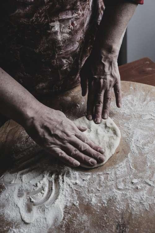 Man processing dough