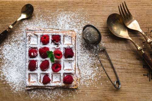 Waffle with sugar and raspberries