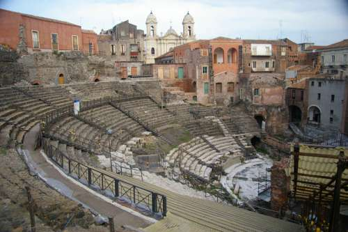 The Church of Saint Francis of Assisi backs the Cavea of the Greek-Roman Theatre in Catania, Italy free photo
