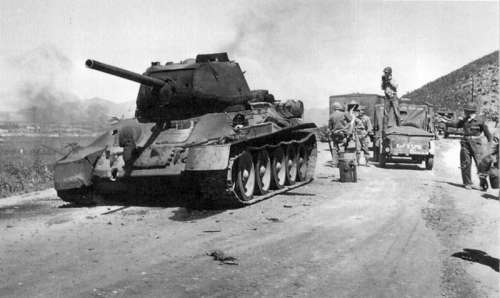 Destroyed T-34 Tank along the road during the Korean War free photo