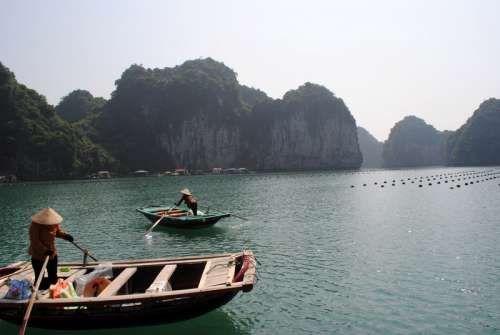 Fisherman in Boats in Vietnam free photo