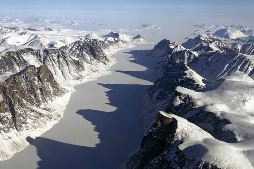 Ice covered fjord on Baffin Island with Davis Strait in the back in Nanuvut, Canada free photo