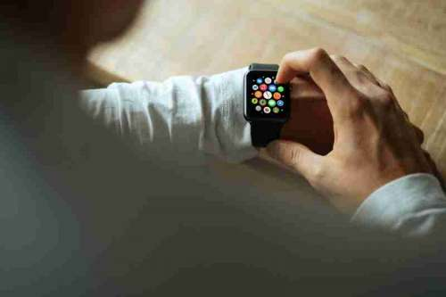 Man Looking at Apple Watch free photo