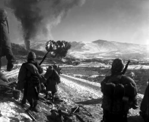 Marines watching explosions to flush out enemies, Korean War free photo