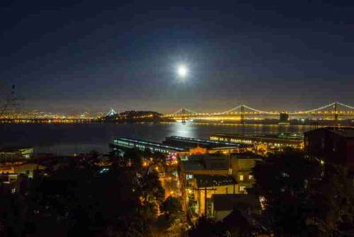 Night Time Cityscape view of Oakland-San Francisco Bay Bridge with sky and moon in California free photo