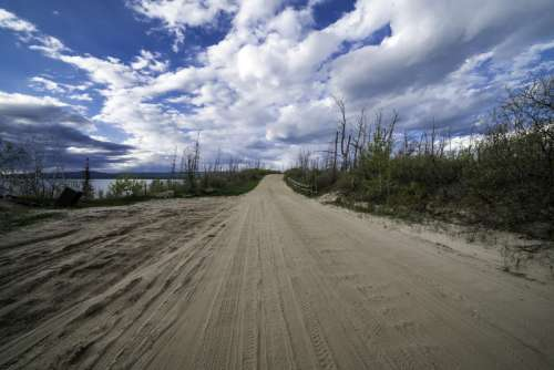 Path around Lesser Slave Lake with sky and clouds free photo