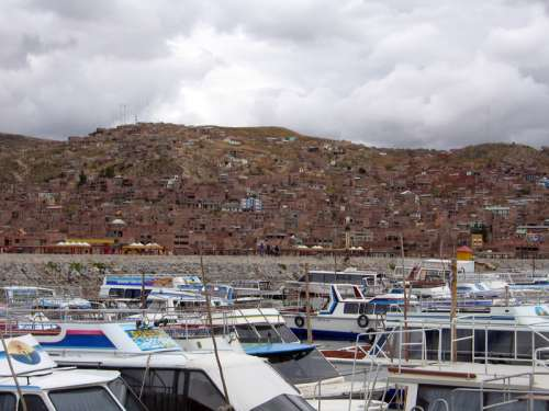 Puno cityscape and marina on Lake Titicaca in Peru free photo