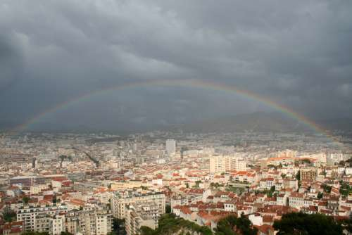 Rainbow over the cityscape of Marseille free photo