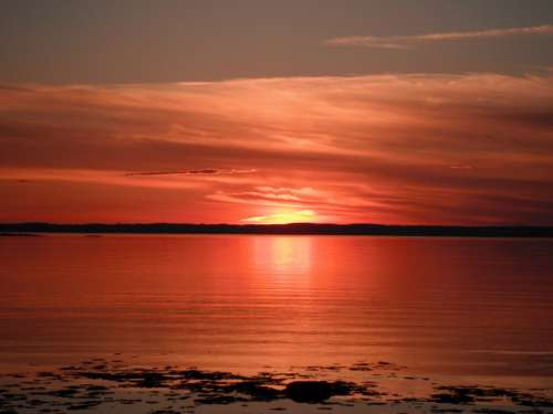 Red Sunset over the Seas in Quebec, Canada free photo