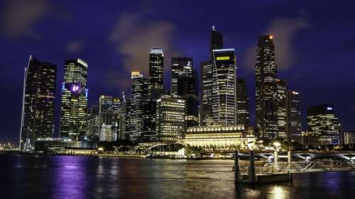 Singapore Skyline with dark blue sky in the background at night free photo