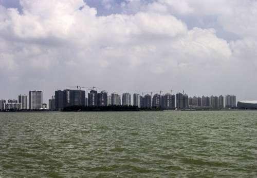Skyline of Suzhou from the lake, China free photo