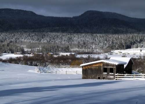 Snowy winter landscape with houses in British Columbia, Canada free photo