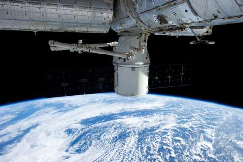 Spaceship above the earth free photo