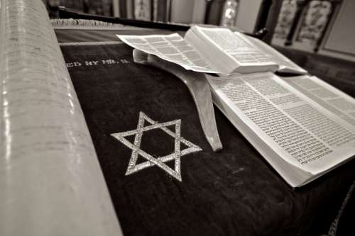 Star of David next to Jewish Torah Scripture free photo