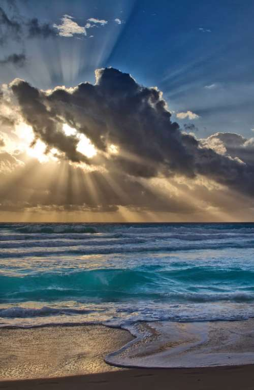 Sun Behind the clouds over the Sea in Cancun, Mexico free photo