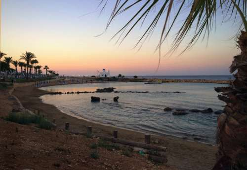 Sunset on the beach in Cyprus free photo