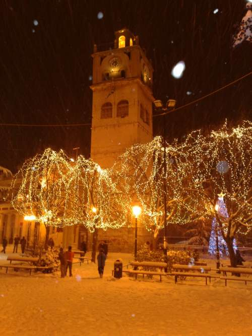 The clock tower during Christmas with Lights in Kozani, Greece free photo