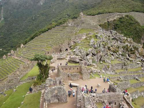 Tourists visiting the Ruins of Machu Picchu, Peru free photo
