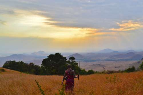 Tribesman looking at the landscape of Kenya free photo
