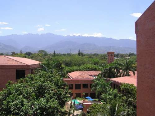 University Icesi and farallones of Cali with mountains behind in the landscape in Cali, Colombia free photo