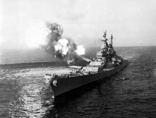 USS Missouri fires a salvo from its 16-inch guns at shore targets during Korean War free photo