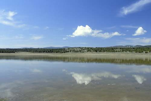 Wetlands across a pond in Montana free photo