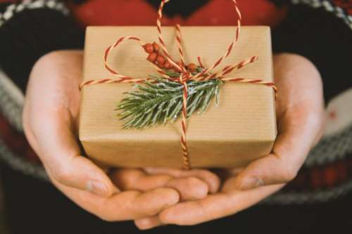 Man's hands hold christmas gift box. Merry Christmas