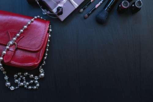Girls table with cosmetics and handbag