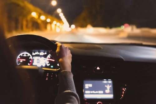 Young woman driving a car at night