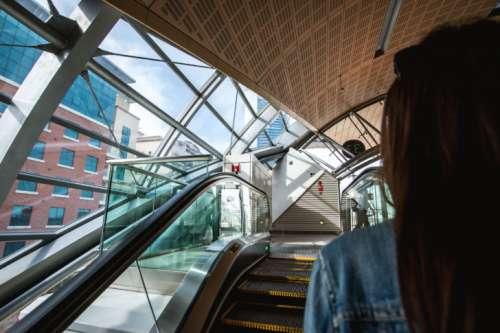 Woman on escalators at metro station