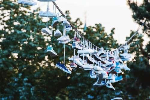 Shoes hanging on a line at city park. Prague, CZE