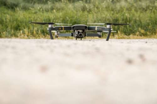 Modern drone on the ground and ready to fly