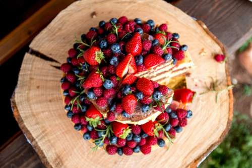 Amazing fruit cake with strawberries, blueberries and raspberries
