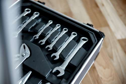 Set of tools in open suitcase