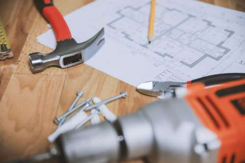 Hammer and other tools with an apartment plan