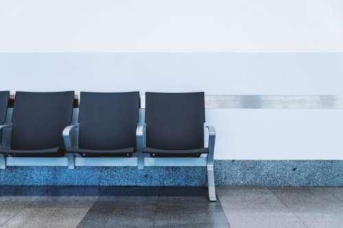 Modern waiting area in the airport. Empty seat