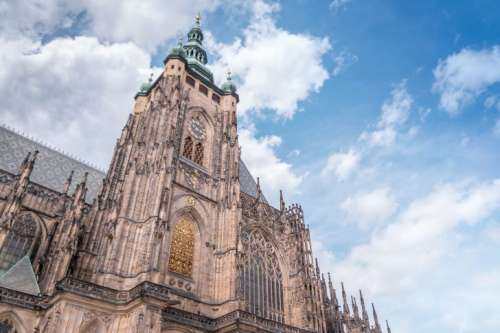 Gothic St. Vitus cathedral in Prague Castle and in the background a beautiful blue sky with clouds