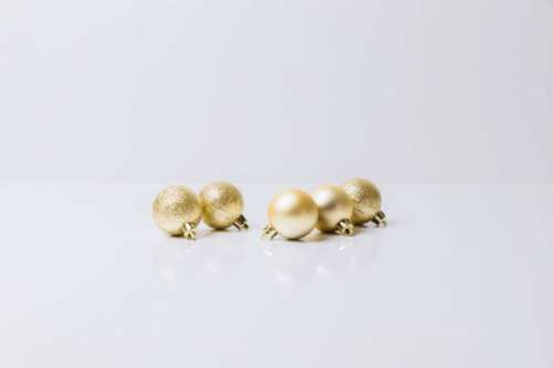 Golden Christmas Ornaments isolated on white