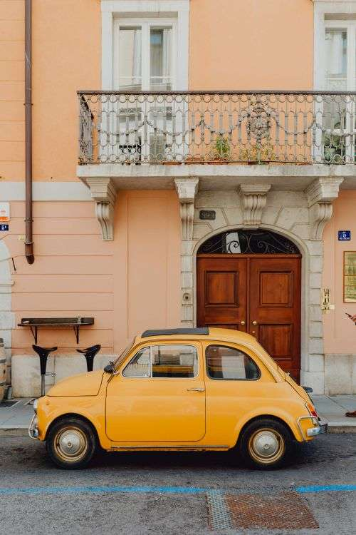 Classic Fiat 500 car parked on the street in the town of Trieste, Italy