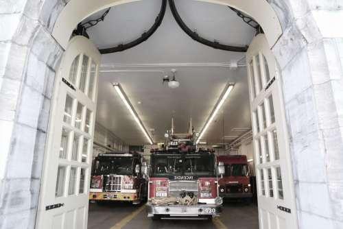 Fire Trucks Leaving Fire Station