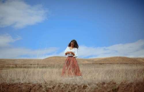 Girl standing in a Field