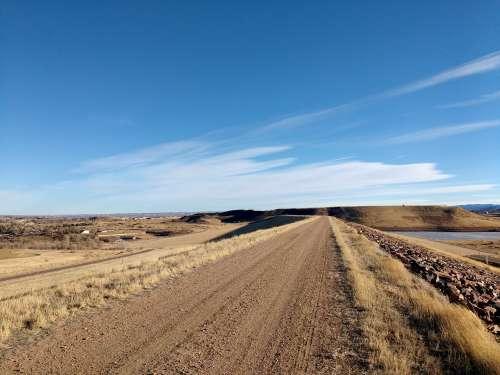 Dirt Road Across Top of Dam