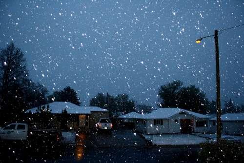 Falling Snow on Neighborhood Street at Night