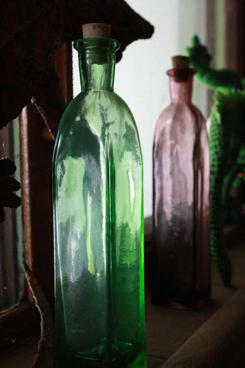 Glass Bottle in Window Sill