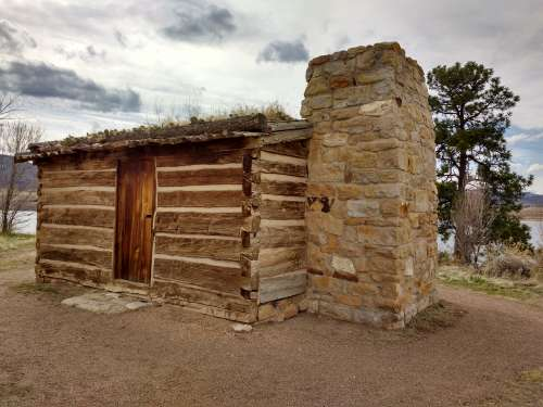 Log Cabin with Stone Chimney