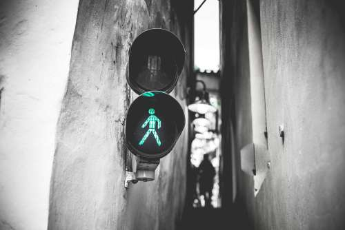 Green Traffic Light Walk Signal in Prague Narrowest Street