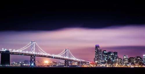 Bay Bridge with San Francisco Skyscrapers Cityscape at Night