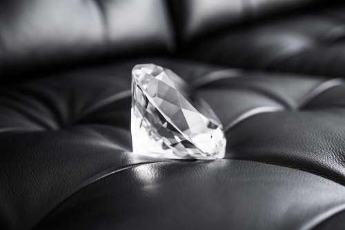 Big Glass Diamond Crystal on Black Leather Sofa
