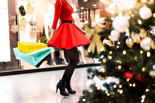Woman in Red Dress Enjoying Christmas Shopping